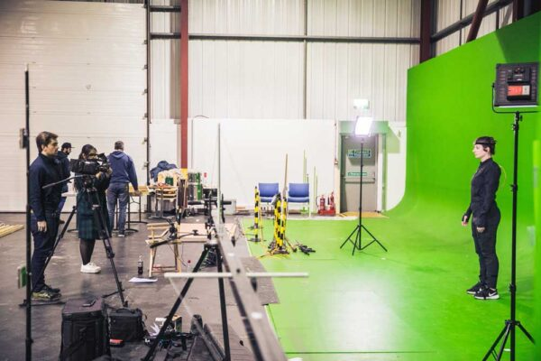 demonstration of how green screen is set up to use chroma key isolation. Subsequent compositing is simpler when the subject contrasts against a flat background color.